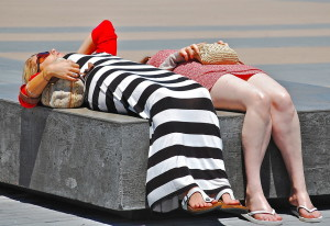 David McSpadden - Tourists nap in sun at Golden Gate Bridge Plaza