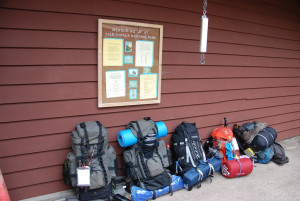 Joe Ross – Backpacks lined up at the camp store
